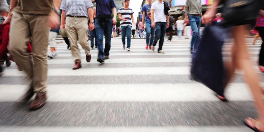 Motion blurred pedestrians on zebra crossing